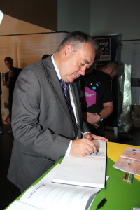 First Minister of Scotland Alex Salmond signing the visitors book